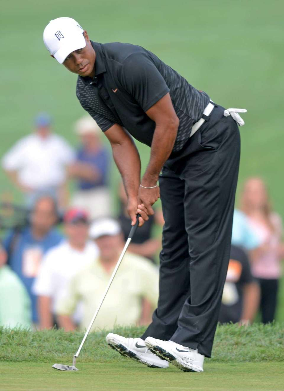 Tiger Woods misses a birdie putt on the