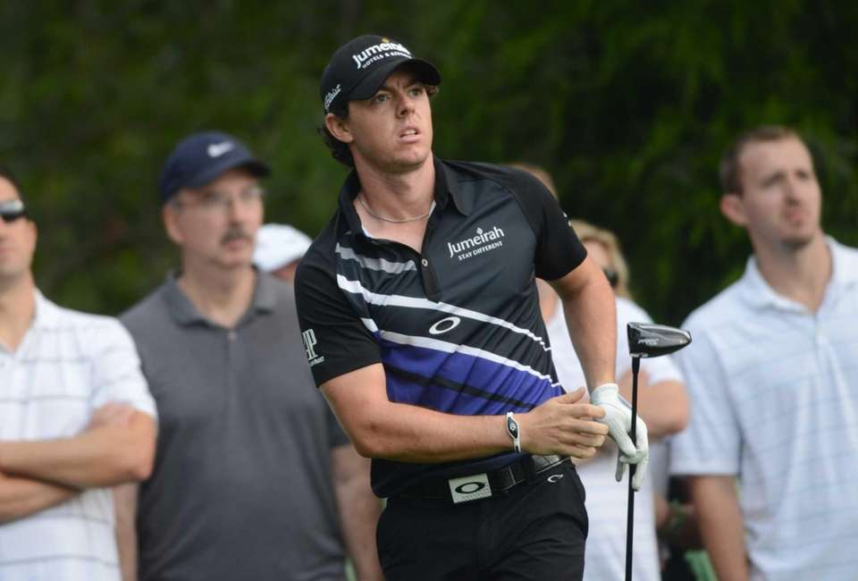 Rory McIlroy watches his drive on the 11th