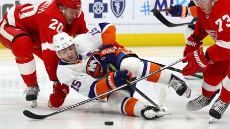 Cal Clutterbuck #15 of the Islanders falls to