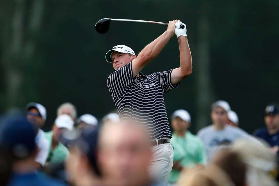 Steve Stricker watches his tee shot on the