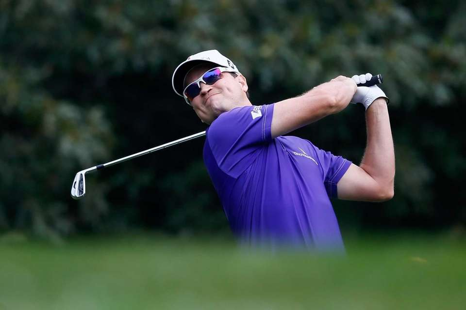 Zach Johnson hits his tee shot on