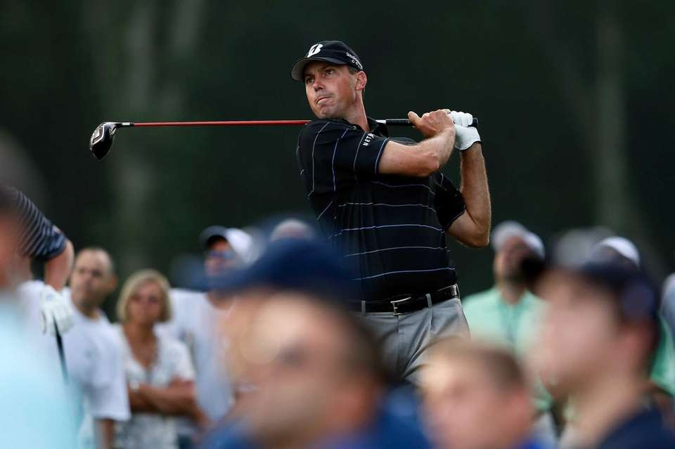 Matt Kuchar watches his tee shot on the