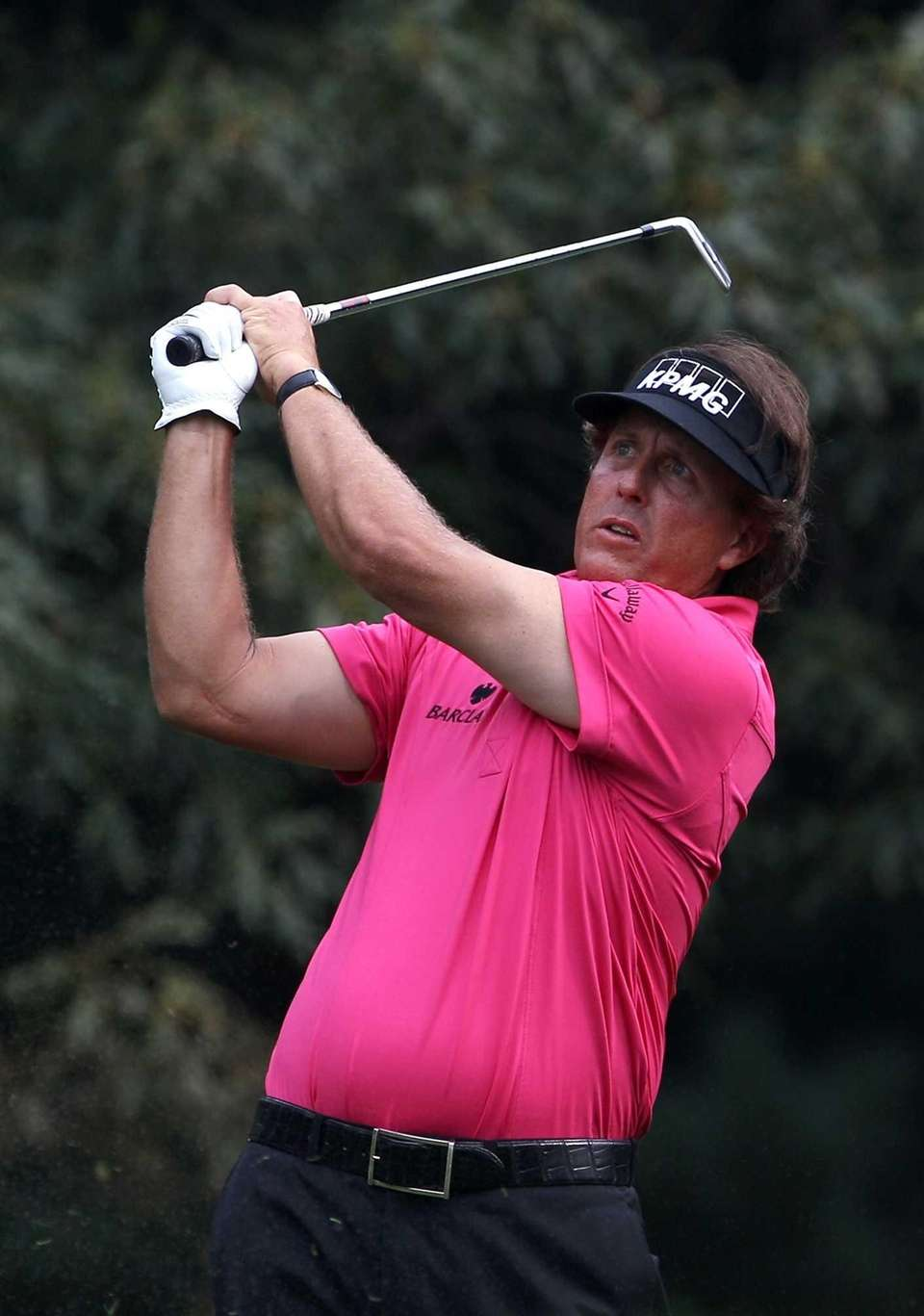 Phil Mickelson watches his tee shot on the