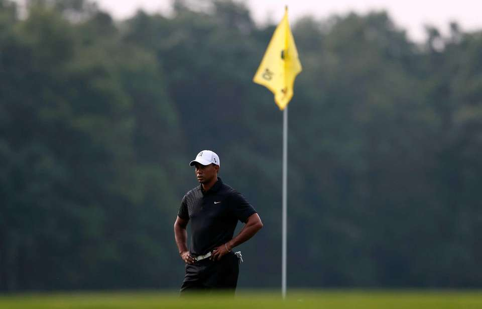Tiger Woods looks on from the 10th hole