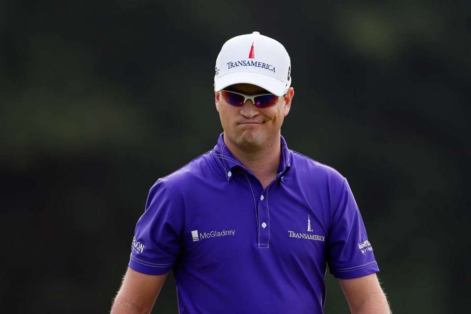 Zach Johnson reacts to a putt on the