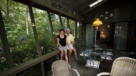 Carolyn and Roger Heyman in their enclosed porch
