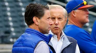 Fred Wilpon (R) talks with Jeff Wilpon during