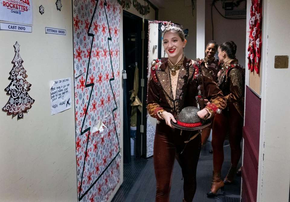 Rockette Sydney Mesher walks though backstage hallways at