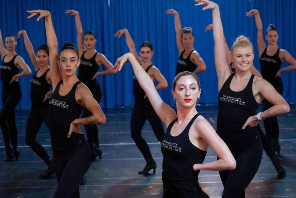 Rockette Sydney Mesher, center right, takes part in