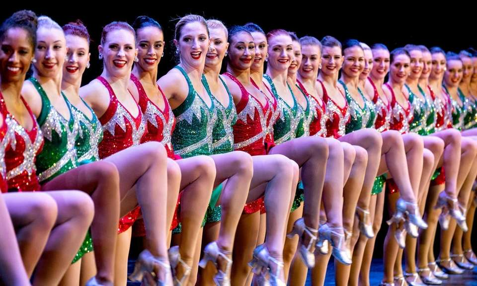 Rockette Sydney Mesher, sixth from left, dances during