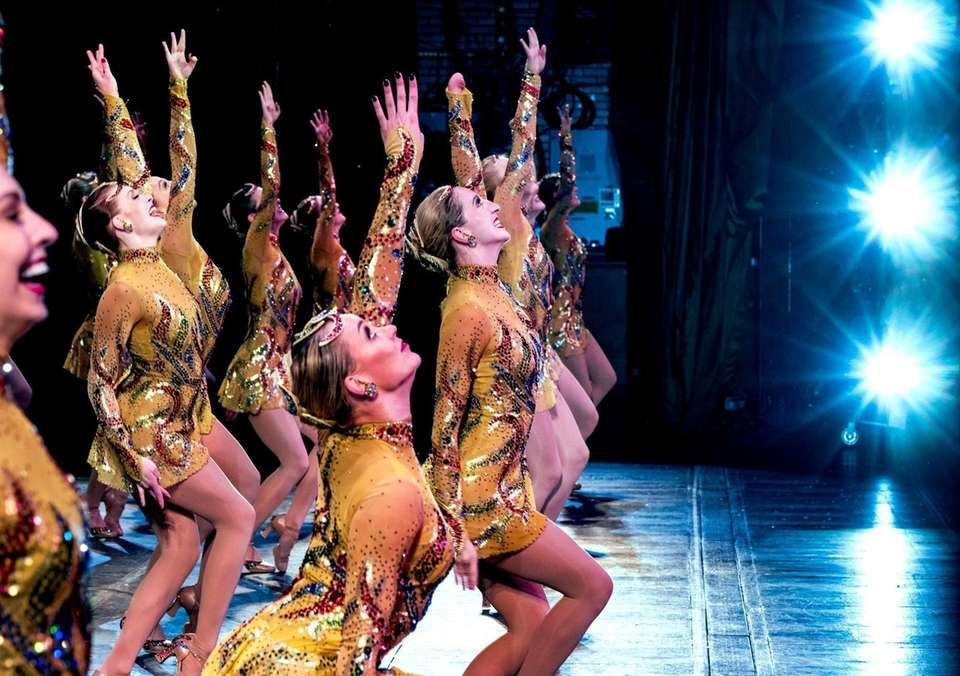 Rockette Sydney Mesher, front center, dances during a