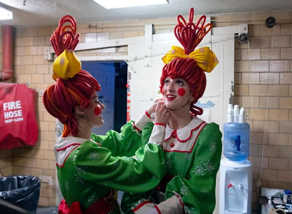 Rockette Sydney Mesher, right, prepares a new costume