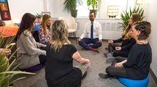Vickram Kooblall, center, participates in Monday meditation group