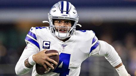 Dak Prescott of the Cowboys runs the ball