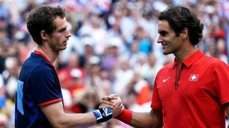 Britain's Andy Murray, left, shakes hands with Switzerland's