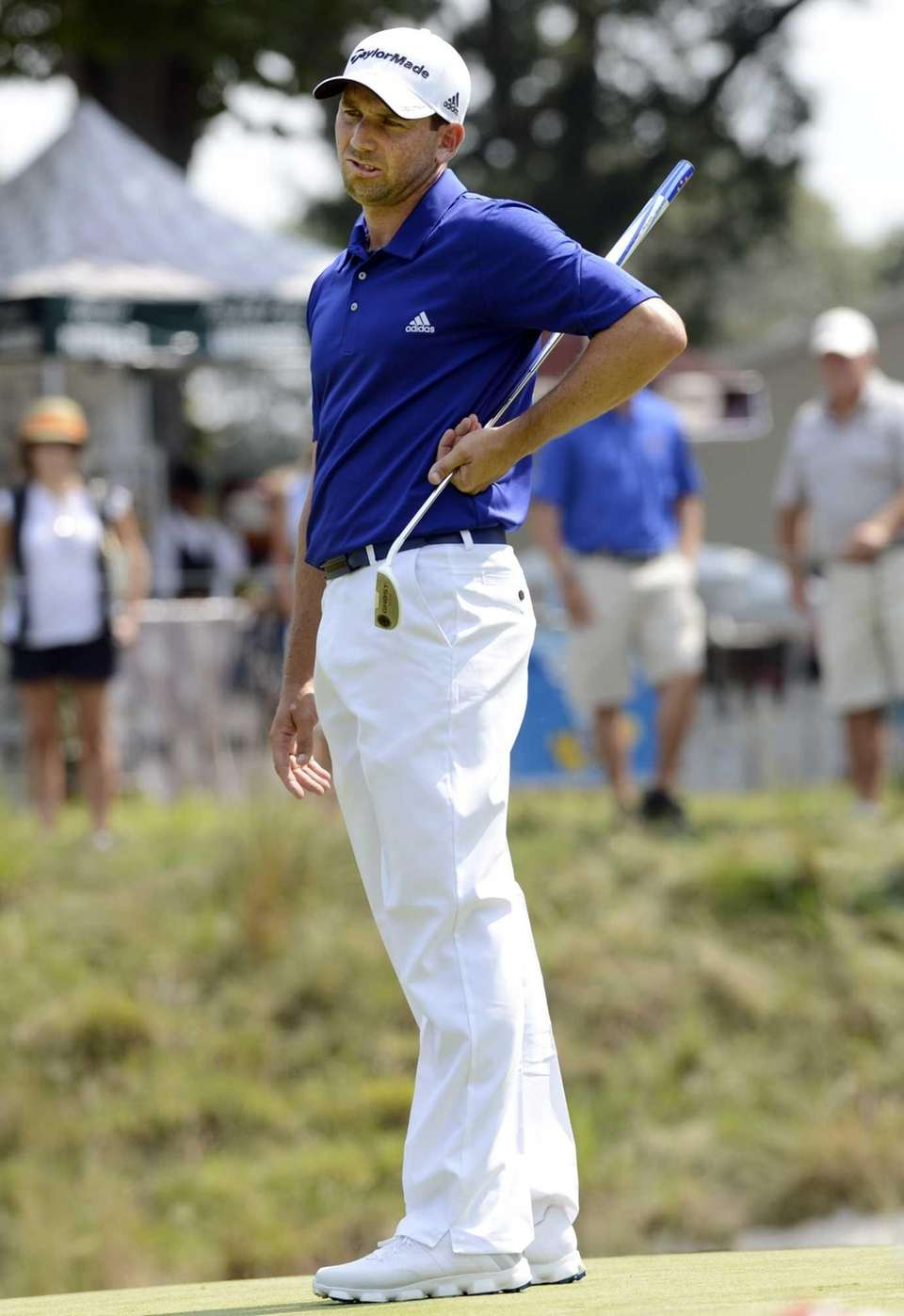 Sergio Garcia of Spain, reacts after missing a