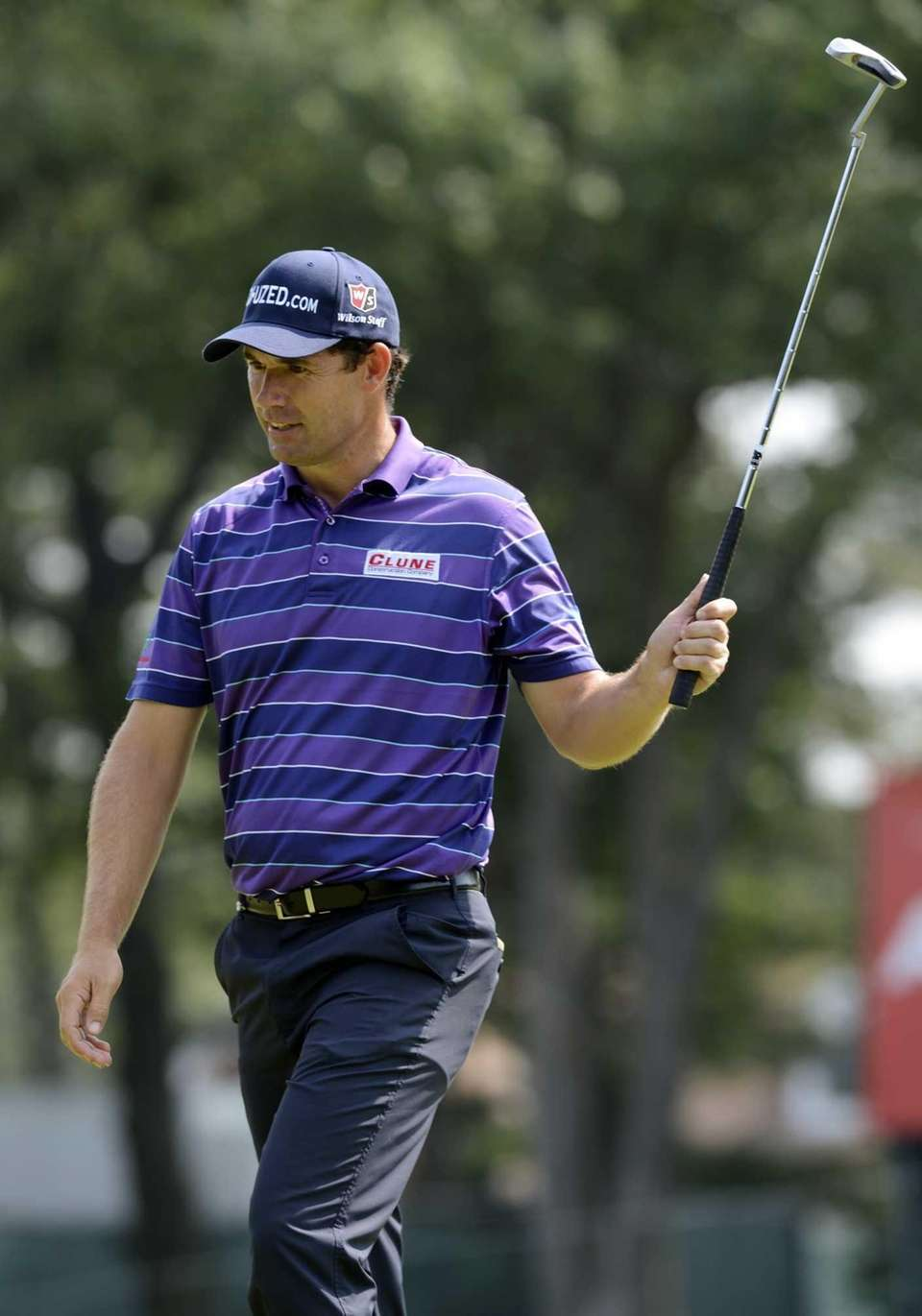Padraig Harrington of Ireland, raises his putter after