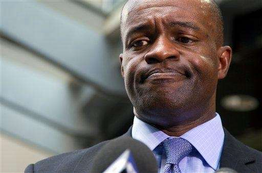 NFL players union chief DeMaurice Smith pauses as