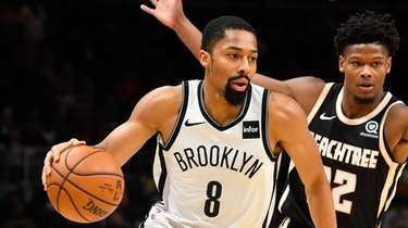 Nets guard Spencer Dinwiddie (8) drives as Atlanta