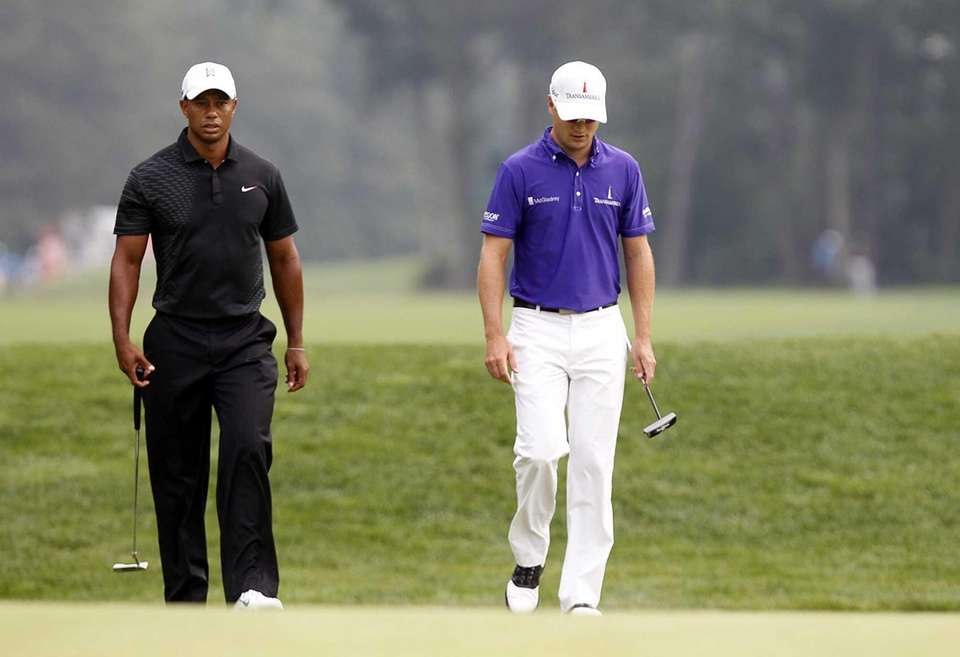 Tiger Woods and Zach Johnson arrive at the