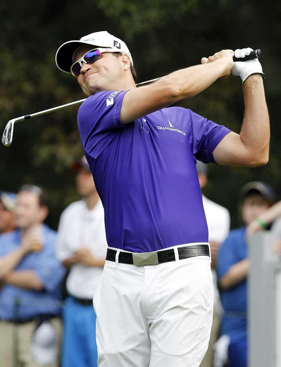 Zach Johnson hits a tee shot at the
