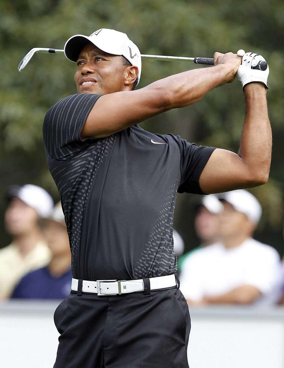 Tiger Woods hits a tee shot at the