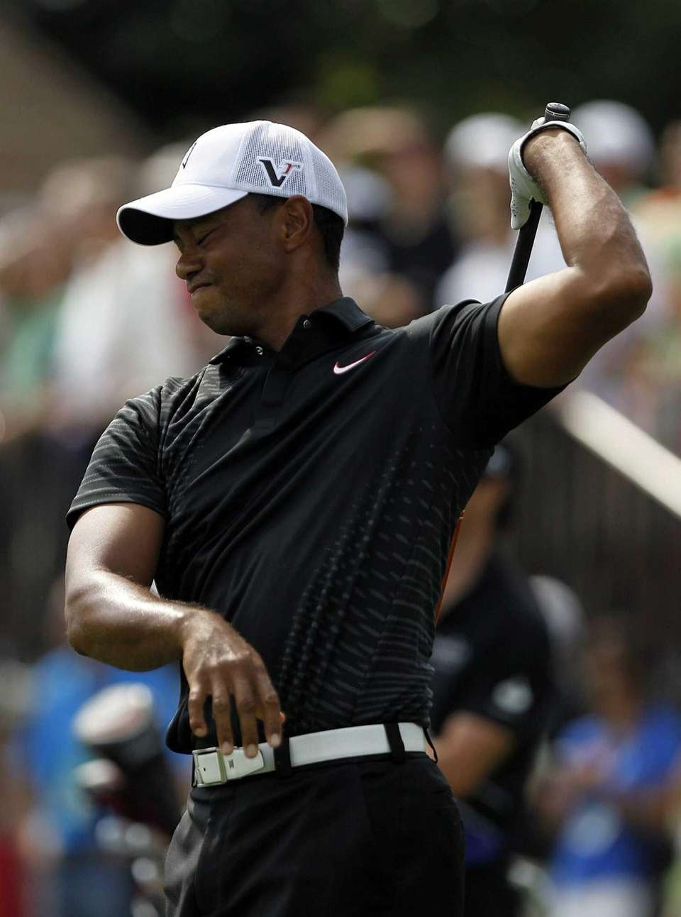 Tiger Woods reacts after a bad tee shot