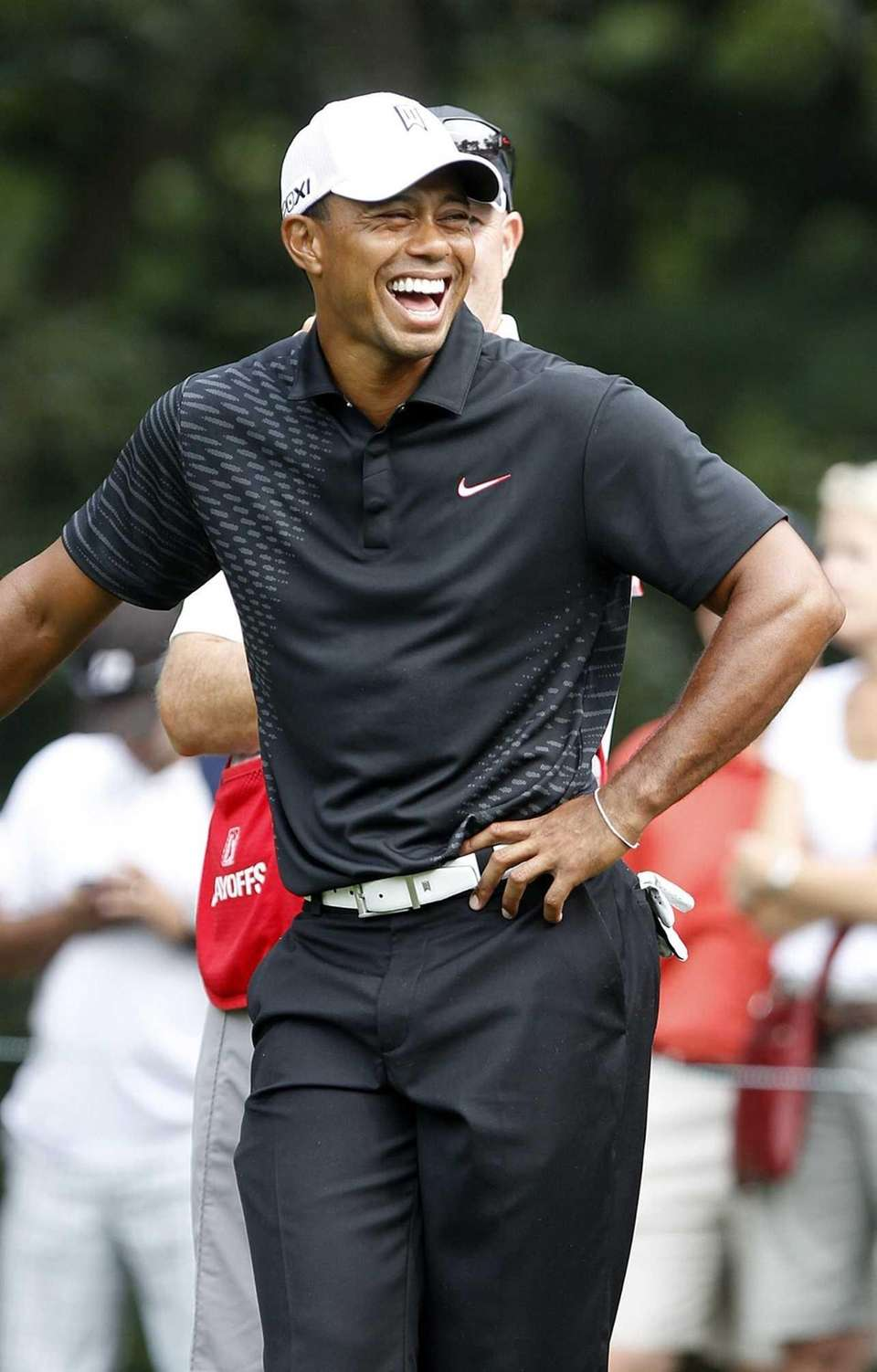 Tiger Woods shares a laugh on the 14th