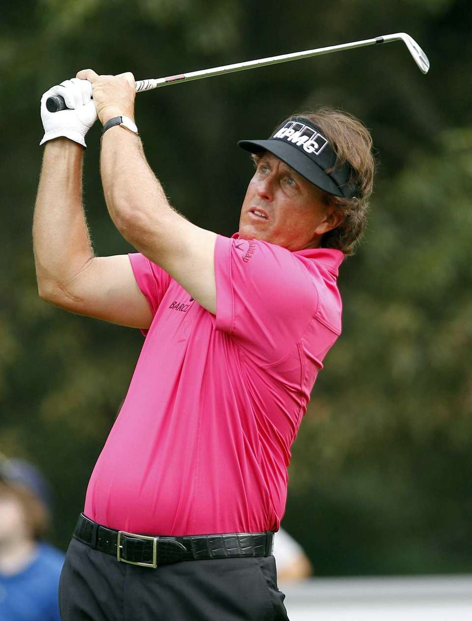Phil Mickelson hits a tee shot on the