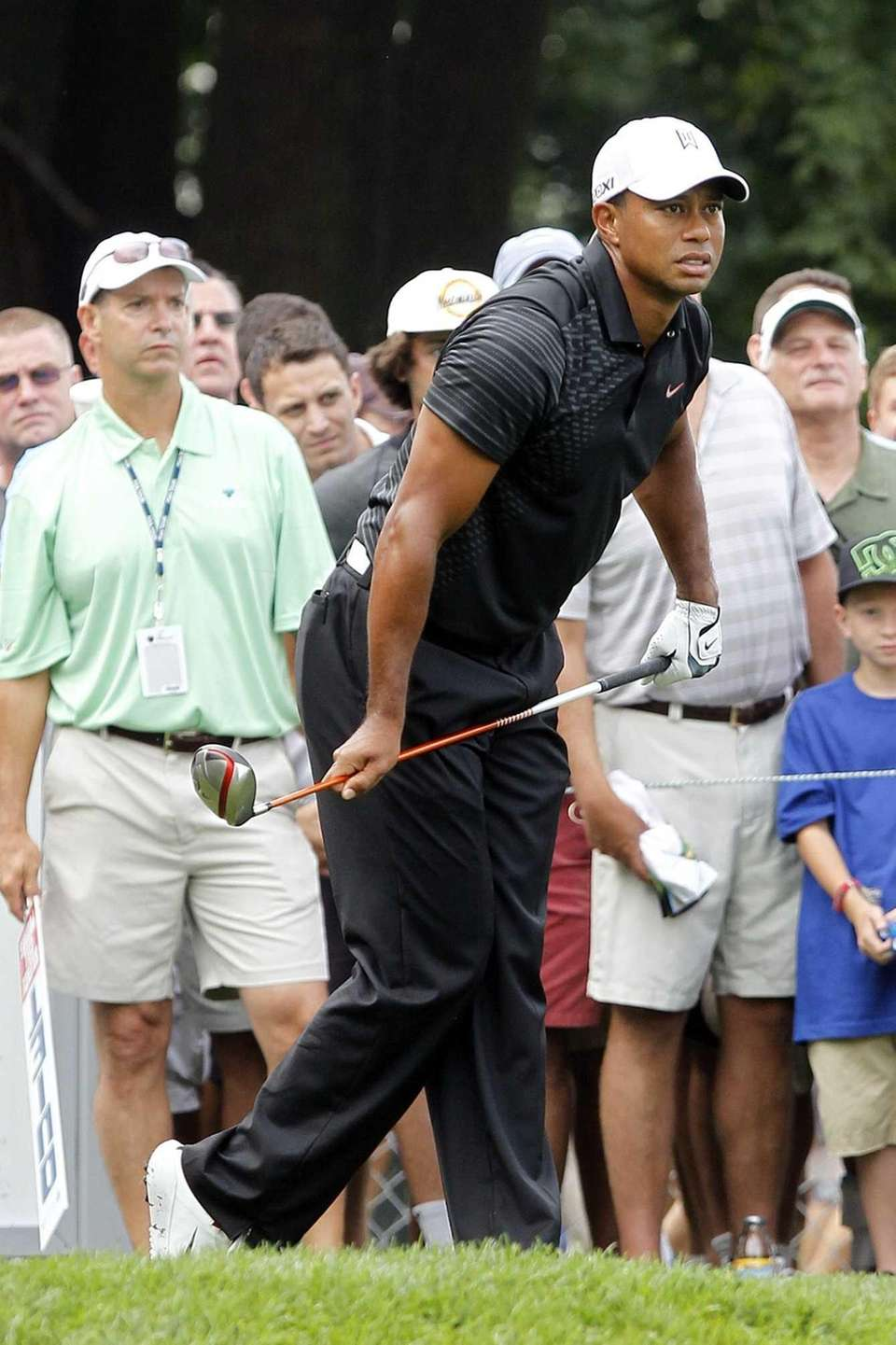 Tiger Woods follows the flight of his ball