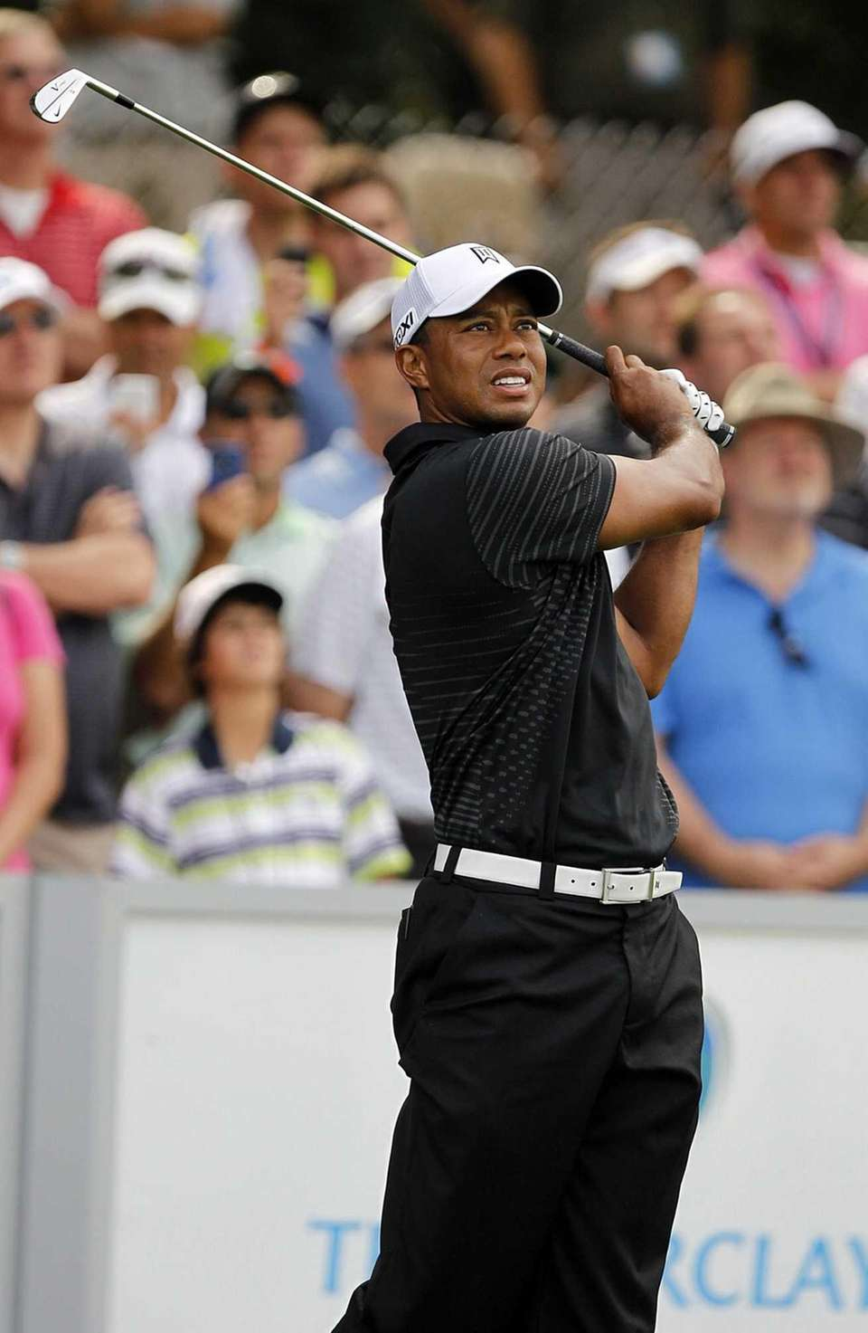 Tiger Woods hits a tee shot on 17.