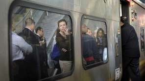 Long Island Rail Road commuters wait for the
