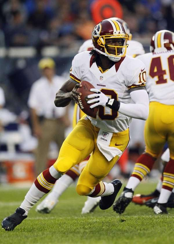Washington Redskins quarterback Robert Griffin III looks for