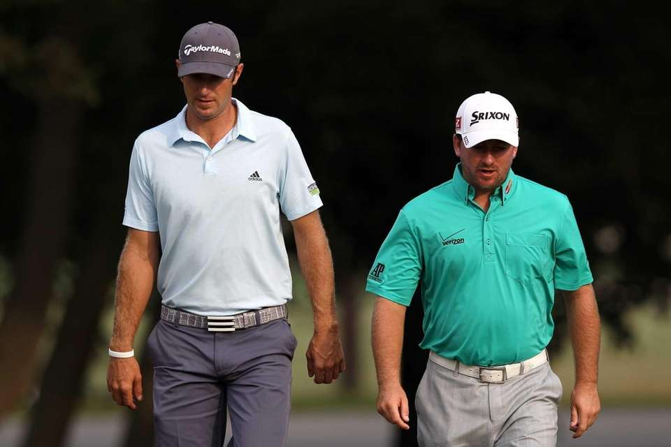 (L-R) Dustin Johnson and Graeme McDowell of Northern