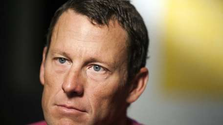 Lance Armstrong pauses during an interview in Austin,