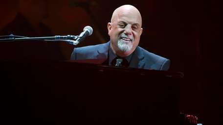 Billy Joel performs during his 100th Madison Square