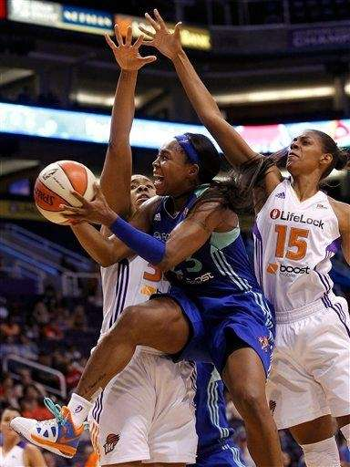 The Liberty's Cappie Pondexter, front, grimaces as she