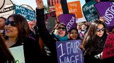 Demonstrators favoring changes to the minimum wage protest