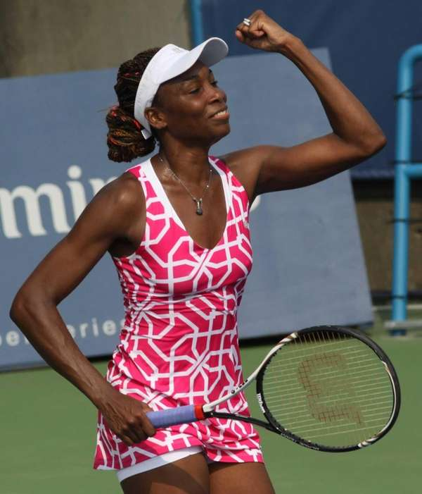 Venus Williams reacts after beating Sara Errani, 6-3,