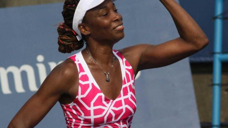 Venus Williams reacts after beating Sara Errani, 6-3,