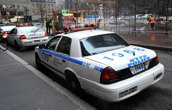 New York Police Department officers in cars in