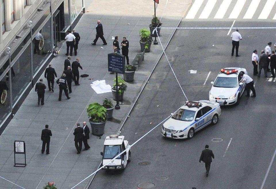 Police converge on a Fifth Avenue sidewalk as