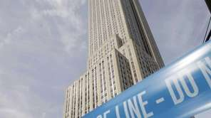 Police crime scene tape blocks 34th Street at