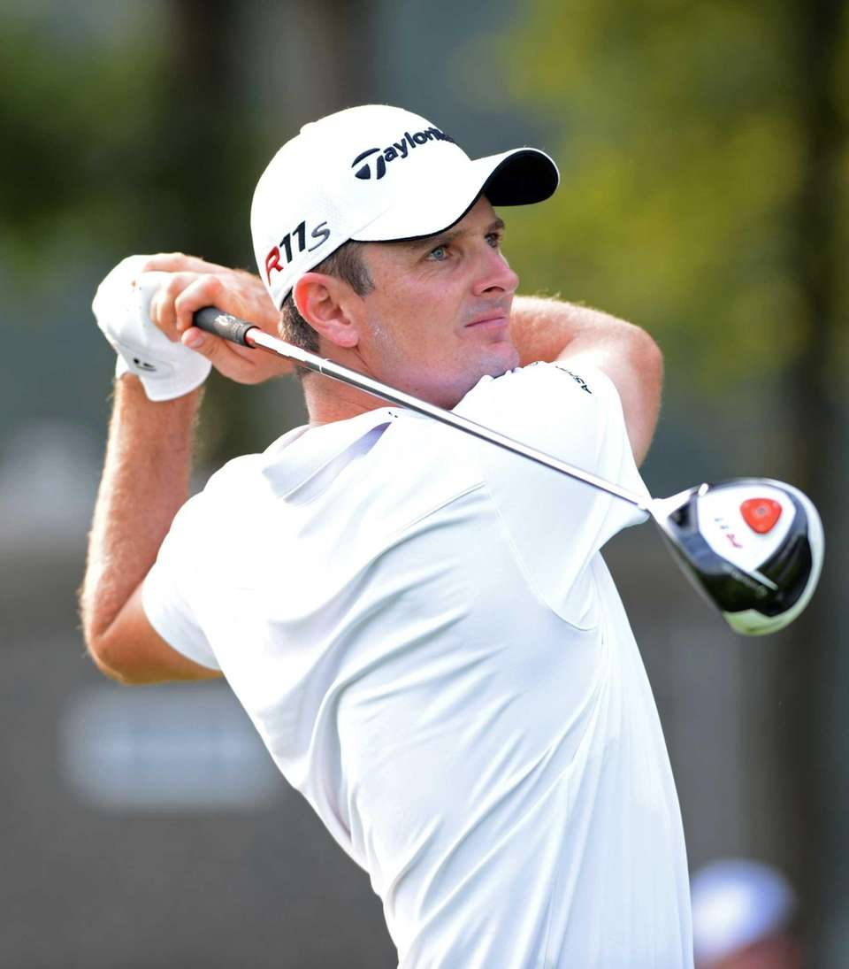 Justin Rose of England tees off on the
