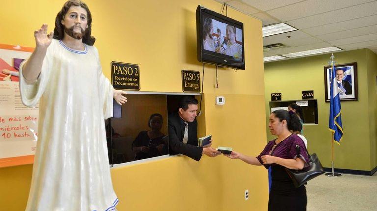 Vice Consul Mauricio Vasquez hands out new passports