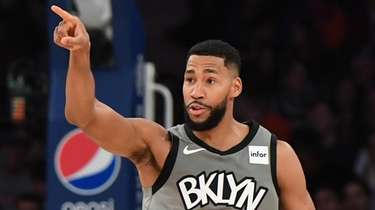 Nets guard Garrett Temple after a three-pointer against