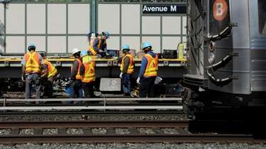 MTA workers create a continuous section welded rail