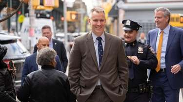 New York City Police Commissioner Dermot Shea, center,