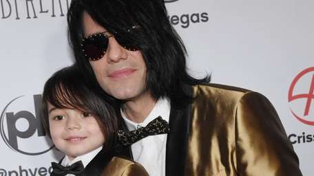 Johnny Crisstopher Sarantakos, 5, and illusionist Criss Angel