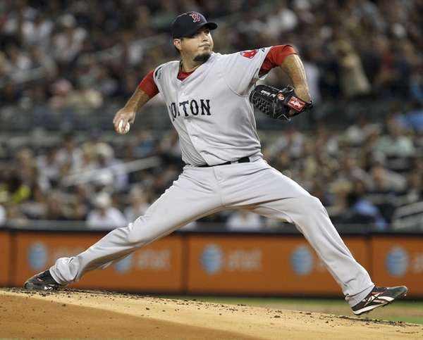 Boston's Josh Beckett pitches during the first inning.